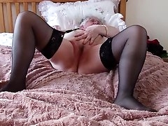 Fat granny in black stockings rubs her..