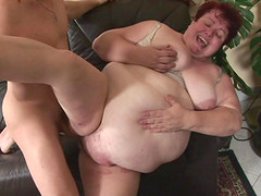 Fat old woman sucking and fucking a..