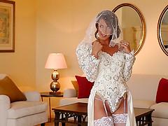 Breathtaking bride dressed in white..