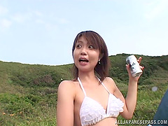 At the beach multiple Japanese bikini..