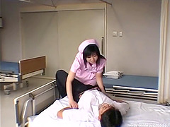 Nurse helps her patient by giving head..