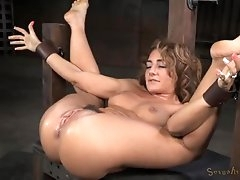 Curly hair girl squirts during bondage..