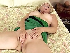 Cute blonde mature babe with big tits..