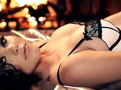 Erotic lingerie posing by brunette..