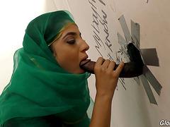 Arab girl sneaks into a room where she..