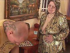 Granny masturbates before she gets..
