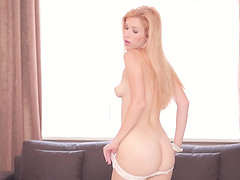 Incredibly sexy blonde gets naked..