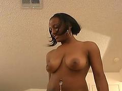 Ebony slut in miniskirt with piercing..