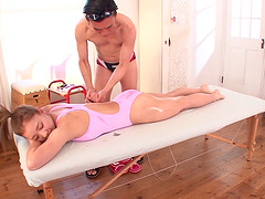 Massaging a Japanese woman's oiled up..