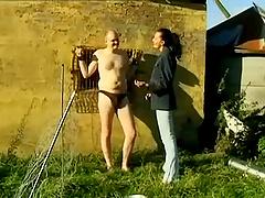 Erotic damsel giving a man in bondage..