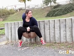 Curvy babe in tight pisses in public