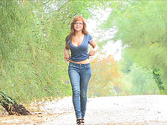 Redhead honey in glasses and jeans..