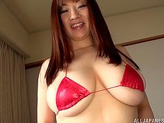 Micro bikini on a big tits Japanese..