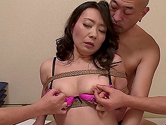 Rope bound Asian milf fingered and..