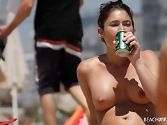 Round tits chick lotions up at the beach