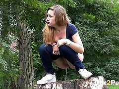 Chick pulls down her jeans and pees on..