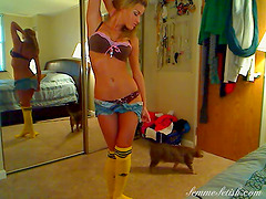 Knee sock wearing blonde dances around..