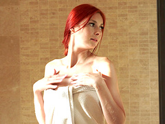 Flaming Redhead Kattie Gold makes a..