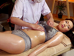 Hot Japanese milf on the massage table..