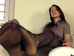 Shiny high heels come off so she can..