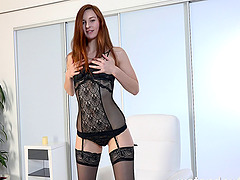 Leggy redheaded hottie in black..