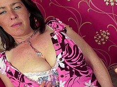 Mature model with huge tits toys her..