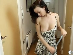 Cleavage girl cleaning house in a cute..