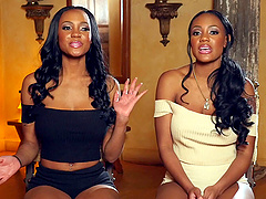 Sexy black twins with big tits oil up..