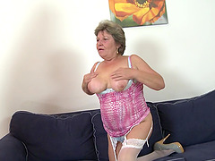 Old lady with sexy saggy tits sits on..