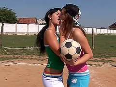Sporty babes play volleyball in the..