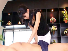 Erotic Asian masseuse takes his cock..