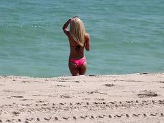 Blonde in a skimpy hot pink bikini..
