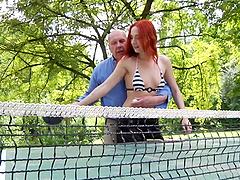 Supremely hot redhead in a bikini..