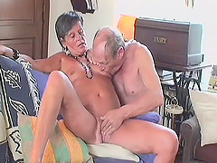 Granny slut lets a pair of guys take..