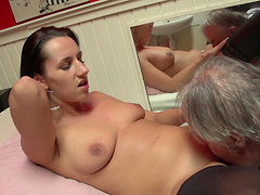 Grandpa goes down on prostitute pussy..