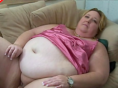 Fatty in sexy pink satin lingerie..