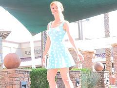 Polka dot dress cutie spreads her legs..