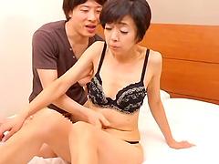 Mature Japanese model spreads her legs..