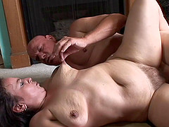 Saggy old slut with a big clit gets a..