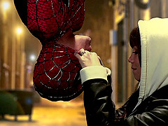 Affectionate babe giving spider man..