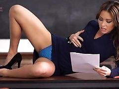 Beauty in a blue dress reads erotica..