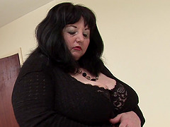 Granny in black lingerie enjoys her..