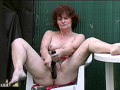Matured granny bending over while..