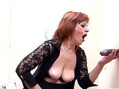 Redhead mature slag fingers her twat..