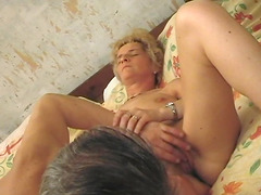 Slutty granny Corrie enjoys having her..
