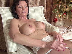 Sexy matured granny widening her legs..