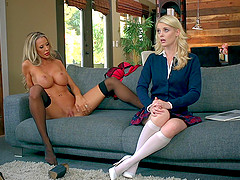 Tanned MILF going lesbian with a pale..