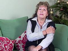 Classy mature granny stripteasing..