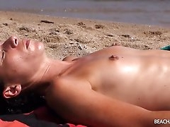 Tanning babes with perky tits at the..