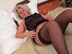 Hot blonde granny in stockings likes..